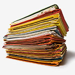 Documents piled up that Pearl Scan can scan to help businesses save time and money in London and accross the UK.